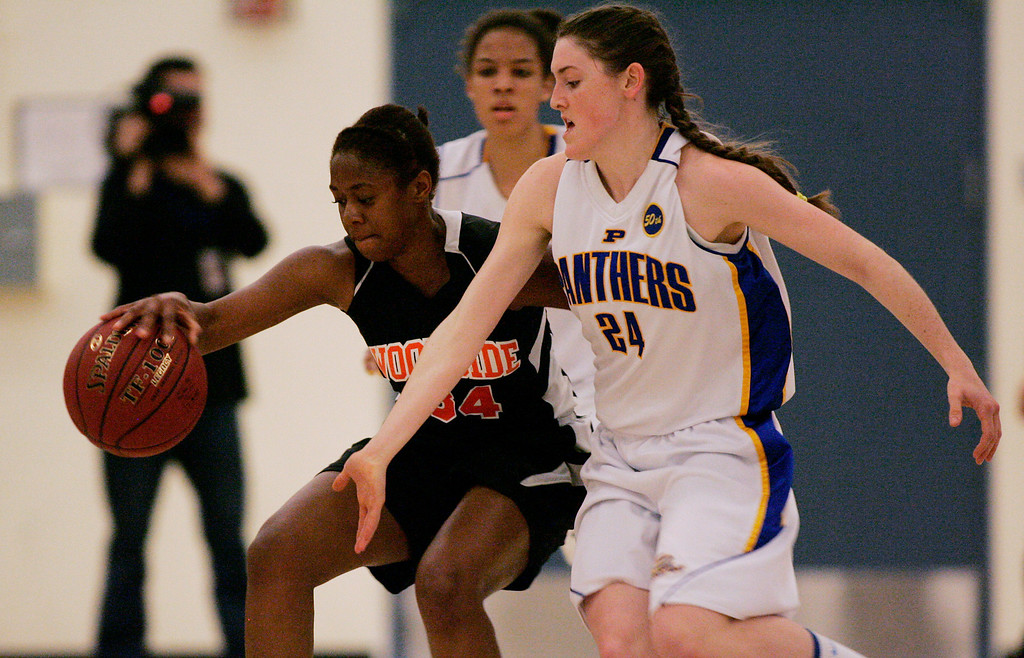 . Woodsides\'s Sharnon Lionel tries to keep the ball away form Presentation\'s Maddie Guidoux in the third quarter during the CCS Division II girls basketball finals at Santa Clara High School in Santa Clara, Calif. on Friday, March 1, 2013. The Presentation Panthers beat the Woodside Wildcats, 49-34. (Jim Gensheimer/Staff)