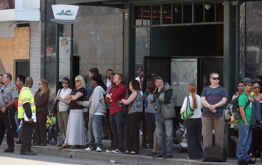 . Commuters wait for an AC Transit bus on 20th Street and Broadway in Oakland, Calif., on Tuesday, July 2, 2013. The BART strike is in its second day and bargaining talks have not resumed. (Jane Tyska/Bay Area News Group)