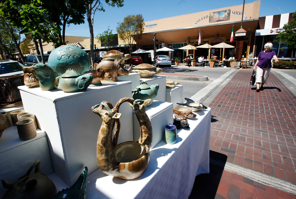 . Sculptures are on display at the booth of artist Laddy Barnett at the 31st annual Sidewalk Fine Arts Festival on Santa Cruz Avenue in downtown Menlo Park on Friday, April 19, 2013. The festival has artworks including painting, jewelry, and sculpture. The festival started Friday and continues to Sunday. The festival is open today, Saturday, from 10 a.m. to 6 p.m. and Sunday from 10 am. to 5 p.m. For more information, visit pacificfinearts.com.  (Kirstina Sangsahachart/ Daily News)