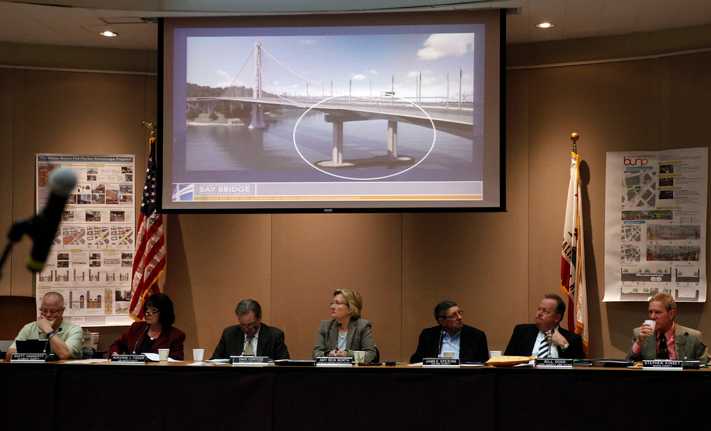 . Metropolitan Transportation Committee members listen to Toll Bridge Program Manager Tony Anziano explaining failed bolts found recently on the new Bay Bridge eastern span construction project. A photograph of the general area atop pier E2 where the failed threaded steel rods were found is projected on the screen during the MTC meeting  Wednesday morning March 27, 2013 in Oakland, Calif. (Karl Mondon/Staff)