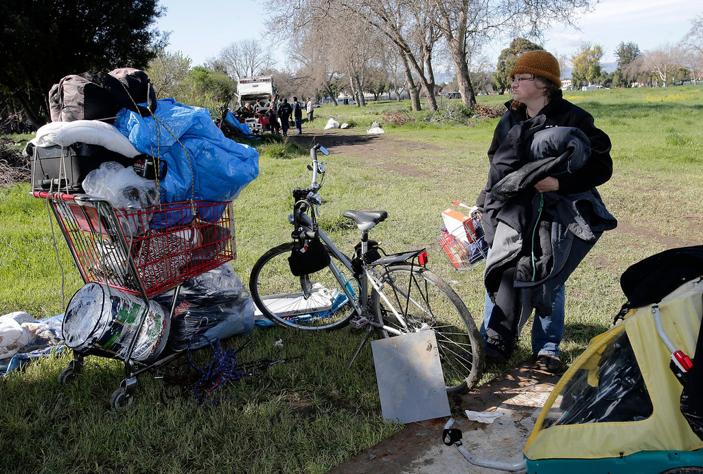 . Wendy Carle packs up her belongings at a homeless encampment on Spring St. in San Jose, Calif. on Friday, March 8, 2013. The city of San Jose began clearing out the area today. Carle says she is not sure where she will go. The encampment has grown to over 100 people in the last six months. Most of the people relocated to this area after cleanup efforts took place in other parts of the city.  (Gary Reyes/ Staff)