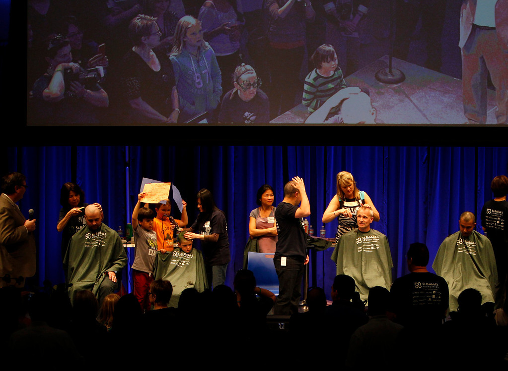 . Volunteers have their head shaved for the St. Baldrick\'s Day head shaving event in support of research for pediatric cancer sponsored by the St. Baldrick\'s Foundation in the NetApp gymnasium at NetApp in Sunnyvale, Calif., on Thursday, March 14, 2013.  (Nhat V. Meyer/Staff)
